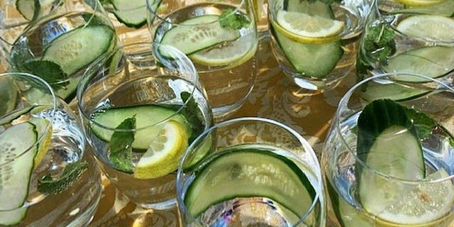 Photo of glasses of water with cucumber and mint
