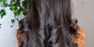 Back of woman's head with curly glossy hair